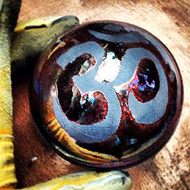 raku-orb-circular-keeper-lidded-jar-om-symbol-275x275